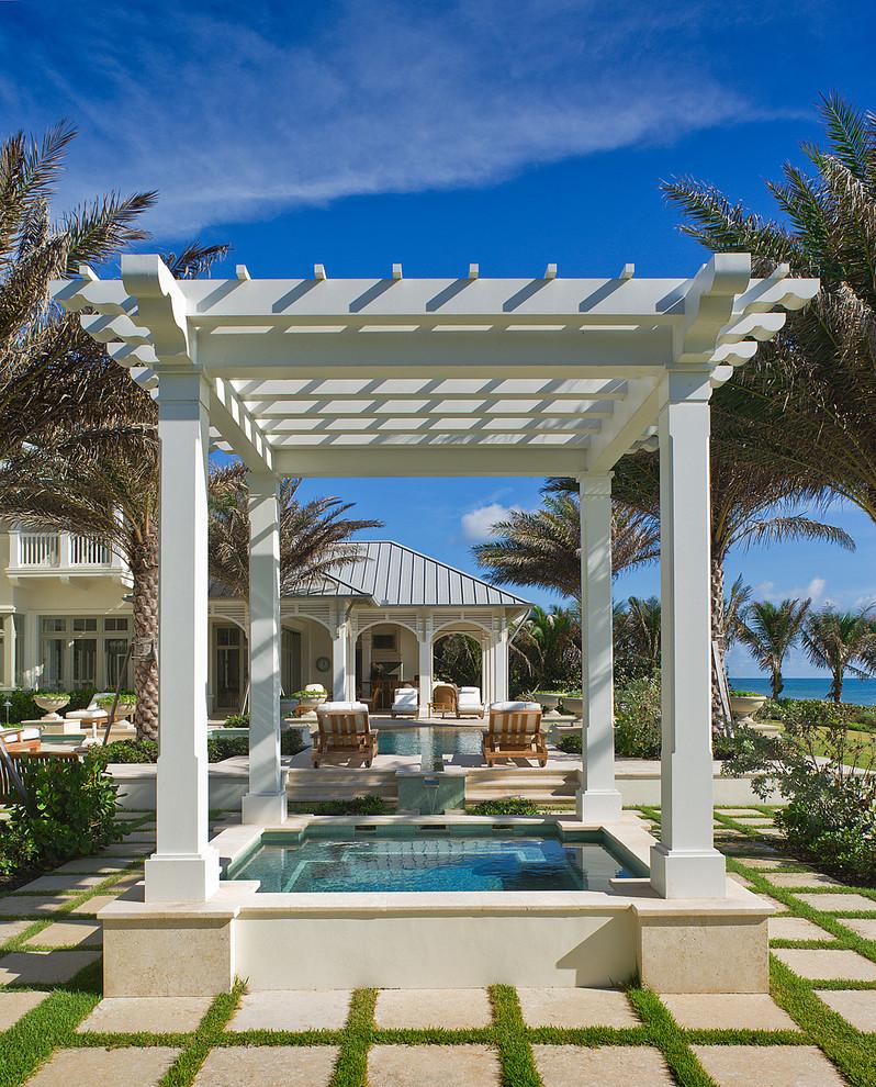 Hot tub - tropical rectangular hot tub idea in Miami