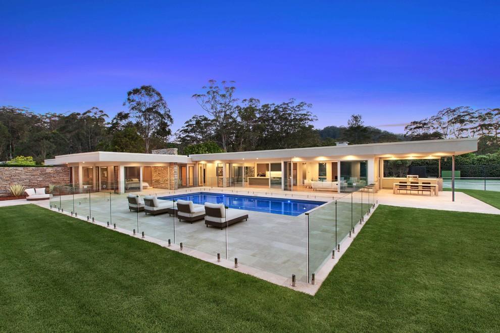 Mid-sized minimalist rectangular pool photo in Central Coast