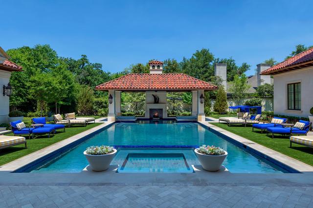 Large tuscan backyard rectangular and concrete paver pool photo in Dallas