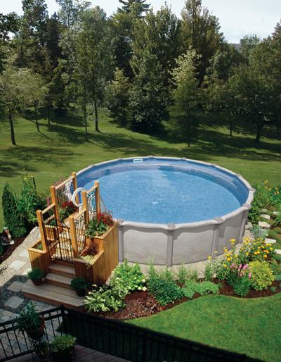 Pool - large transitional backyard custom-shaped aboveground pool idea in Other