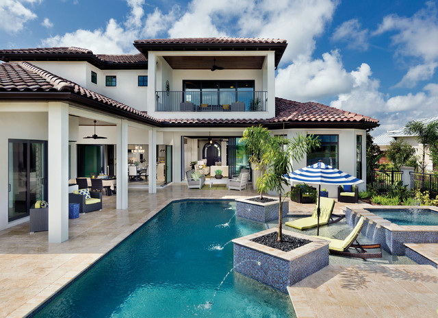 Example Of A Huge Tuscan Backyard Tile And Custom Shaped Pool Fountain  Design In Tampa