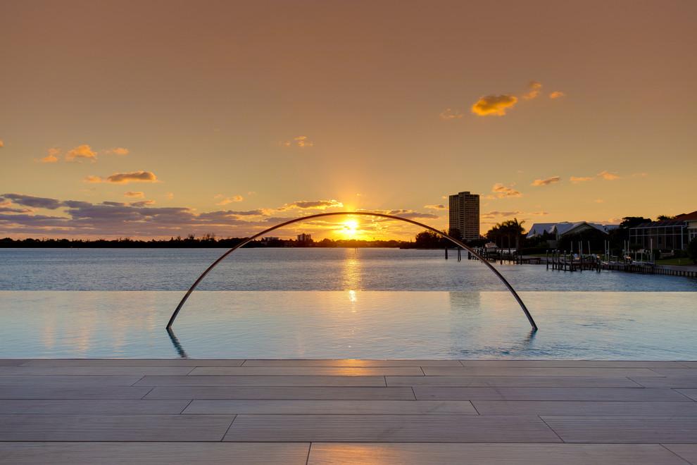Island style pool photo in Tampa