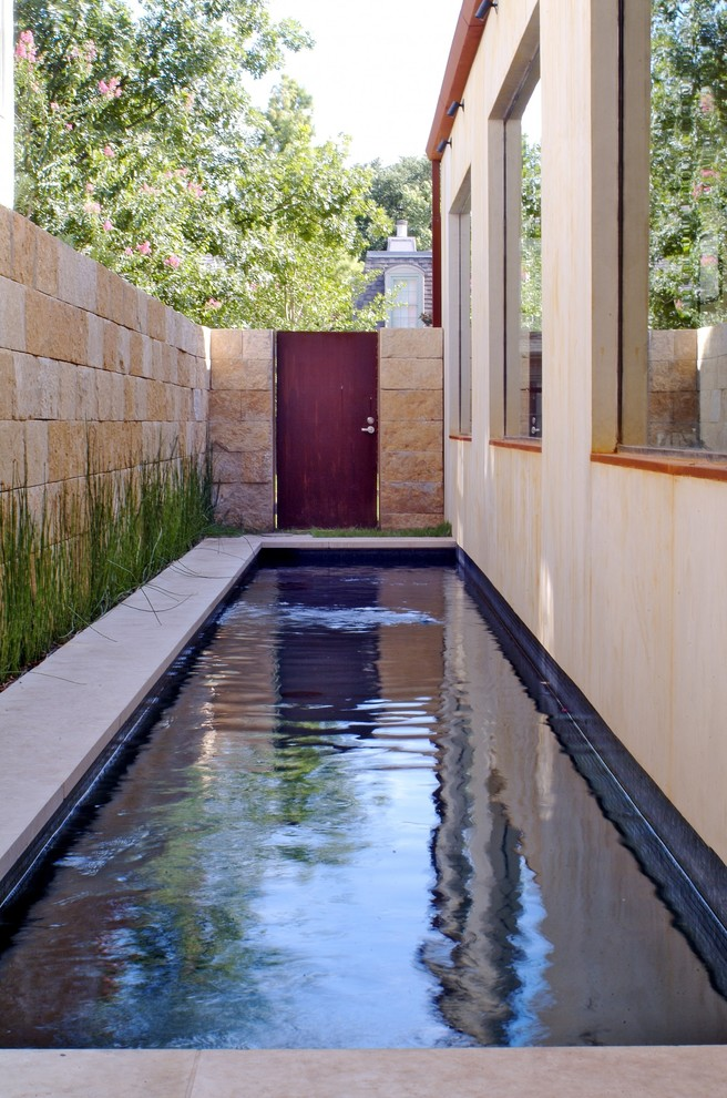 Small transitional side yard concrete and rectangular lap pool photo in Dallas
