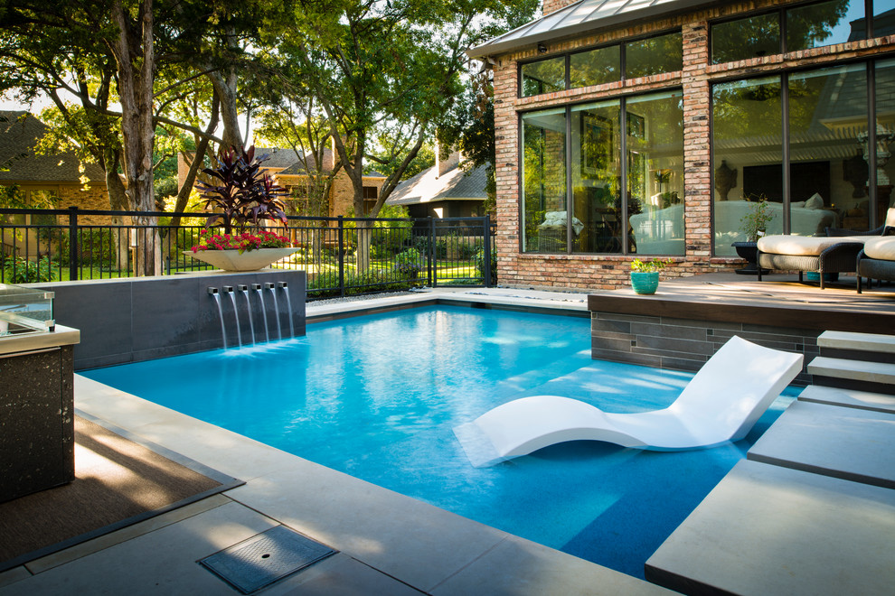 Inspiration for a small modern backyard stone and l-shaped pool remodel in Dallas