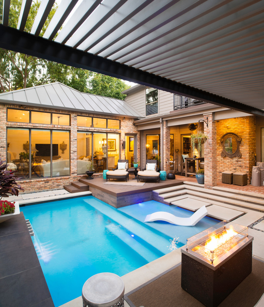 Example of a small minimalist backyard stone and l-shaped pool design in Dallas