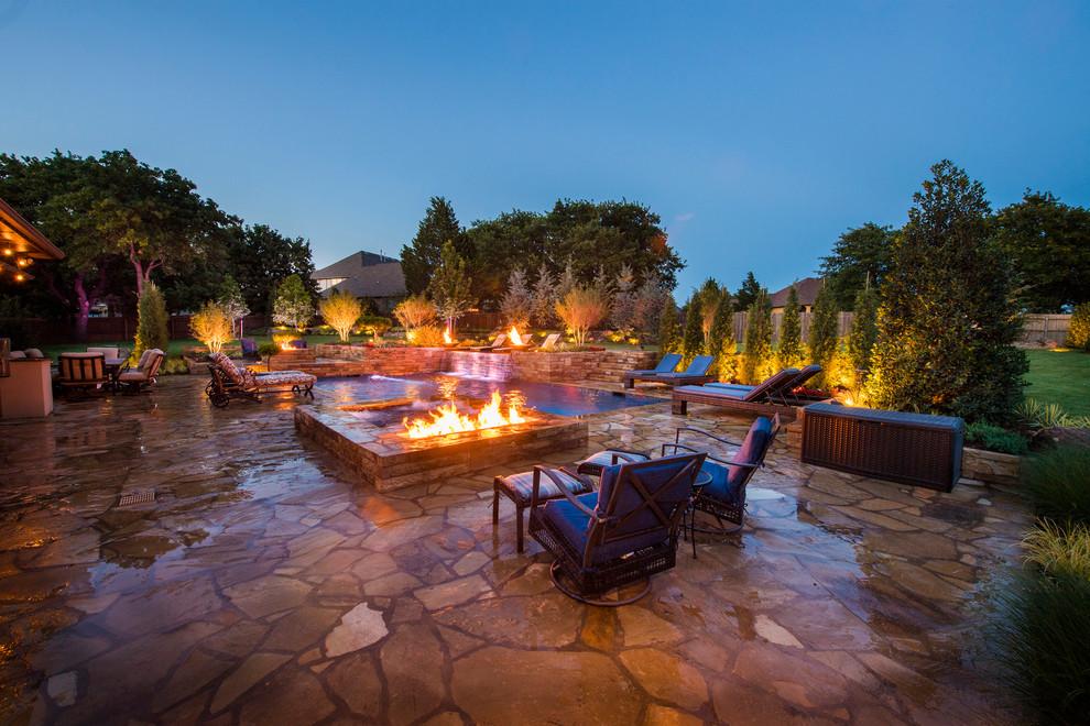 Mid-sized minimalist backyard stone and rectangular lap hot tub photo in Oklahoma City