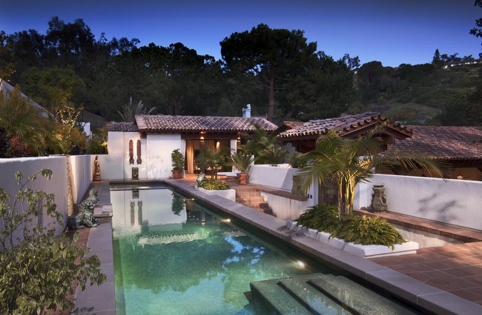 Large tuscan backyard tile and rectangular lap pool fountain photo in San Diego