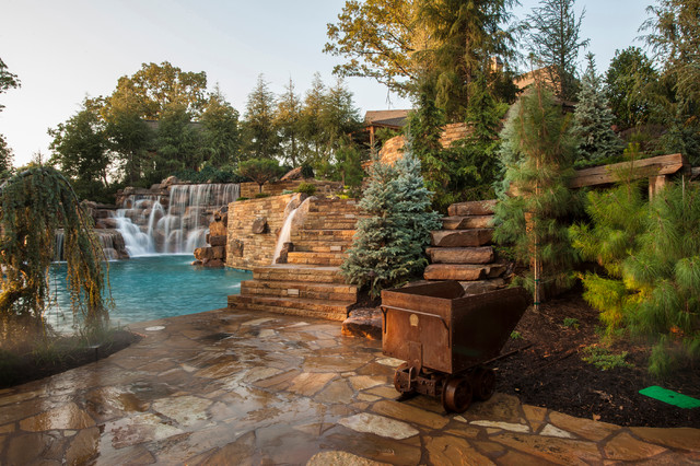 Mountain mine themed pool with waterfalls slide and more for Innovative pool design king s mountain