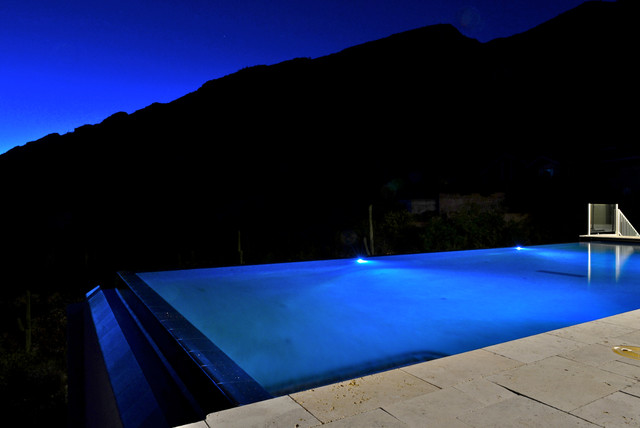 Mountainside Infinity Pool With Multicolored Lighting Pool