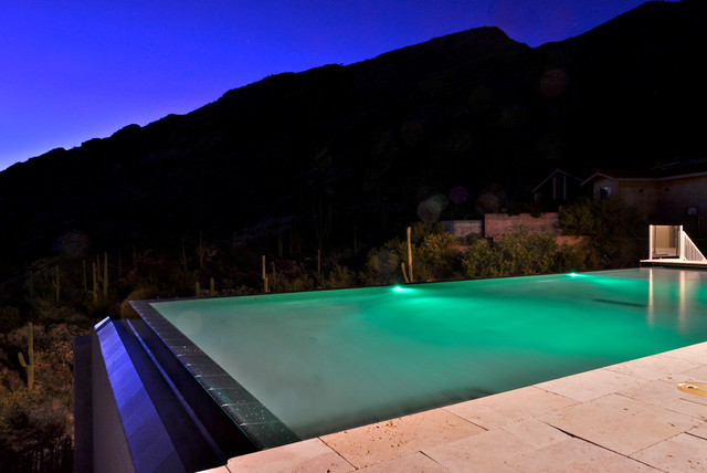 mountainside infinity pool with multicolored lighting. Black Bedroom Furniture Sets. Home Design Ideas