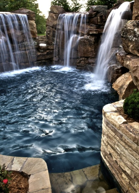 Multiple waterfalls and diving ledges highlight this for Pool design okc