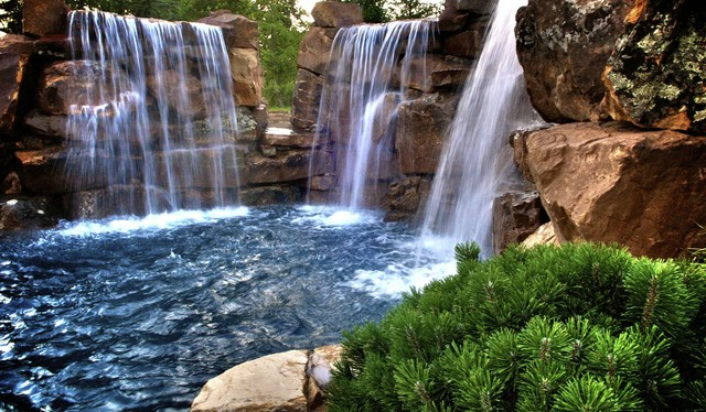 Multiple Waterfalls and Diving Ledges Highlight This Swimming Pool rustic-pool