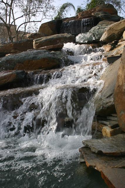 Natural Boulder Pool, Fountain, Fiber optic squirters traditional-pool