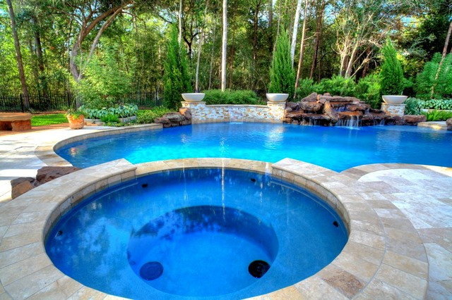 Natural pool with rock waterfall bridge spa and pergola for Natural rock swimming pools