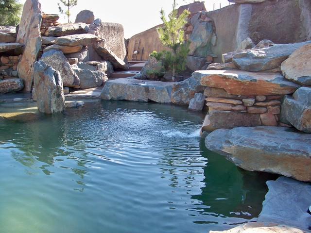 Natural rock boulder pool traditional pool for Natural rock swimming pools