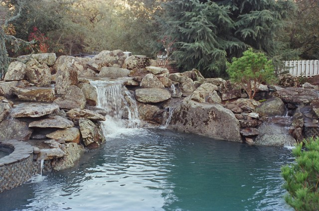 Natural rock waterfall and pool rustic pool san for Garden rock pool