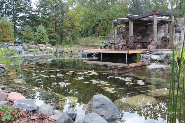Natural Swimming Pool With Faux Ruin Shelter Rustic