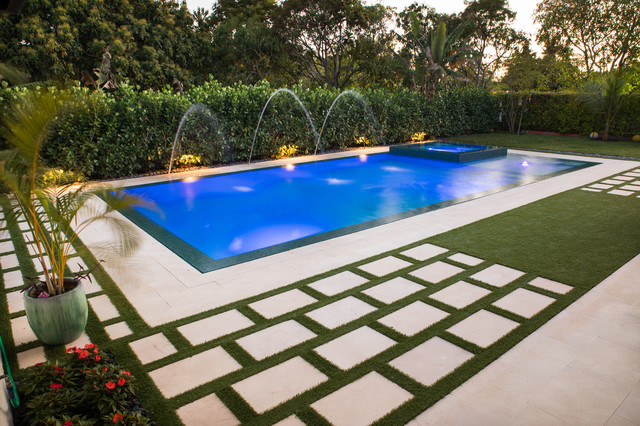 Example Of A Large Trendy Backyard Rectangular Lap Pool Fountain Design In  Miami