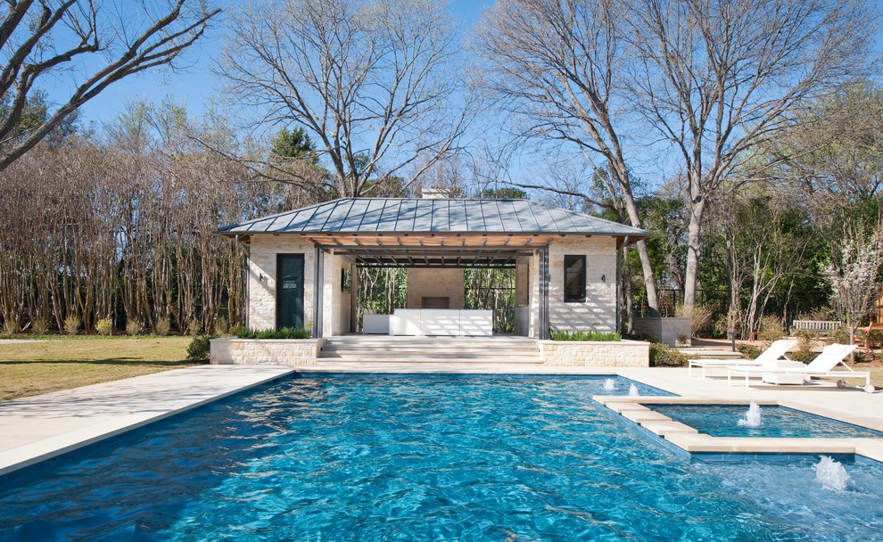 Example of a trendy rectangular pool house design in Dallas