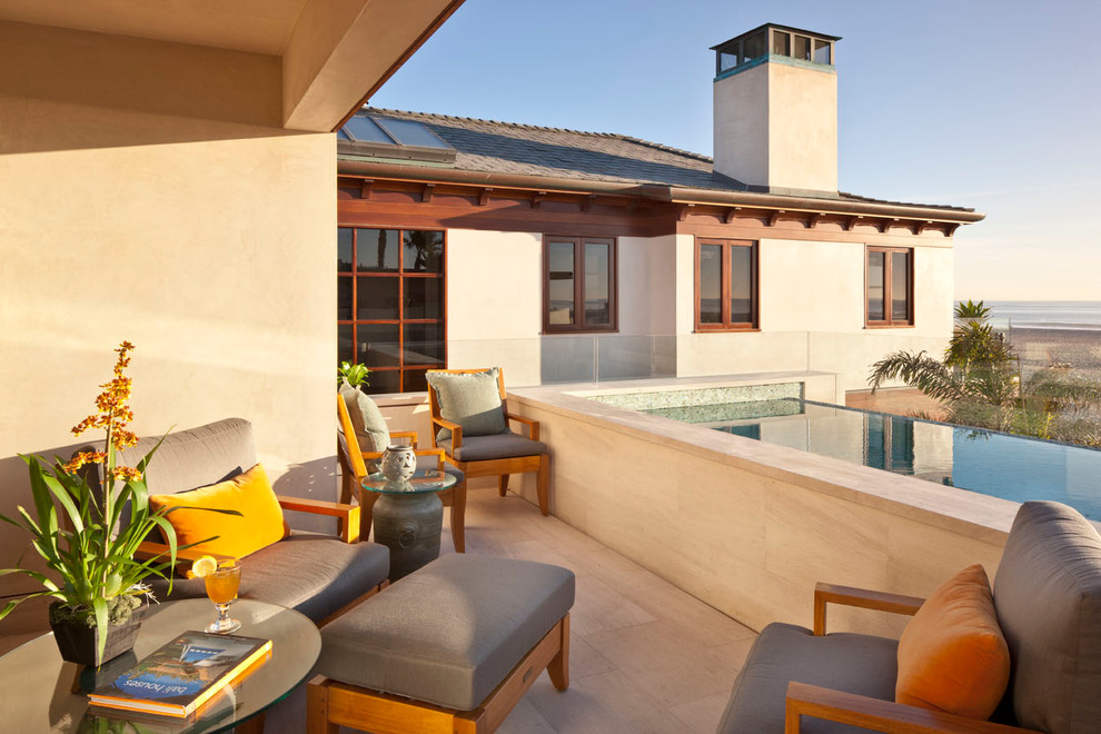 Inspiration for a contemporary side yard tile and rectangular infinity hot tub remodel in Los Angeles