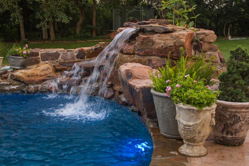 Pool fountain - mid-sized backyard custom-shaped pool fountain idea in Oklahoma City