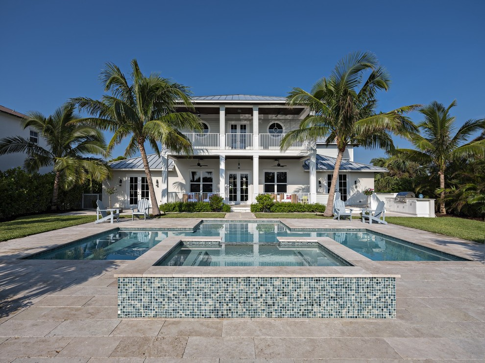 Beach style backyard tile and custom-shaped lap pool photo in Miami