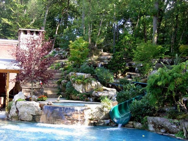 Old westbury swimming pool with water slide waterfalls for Garden pool slide