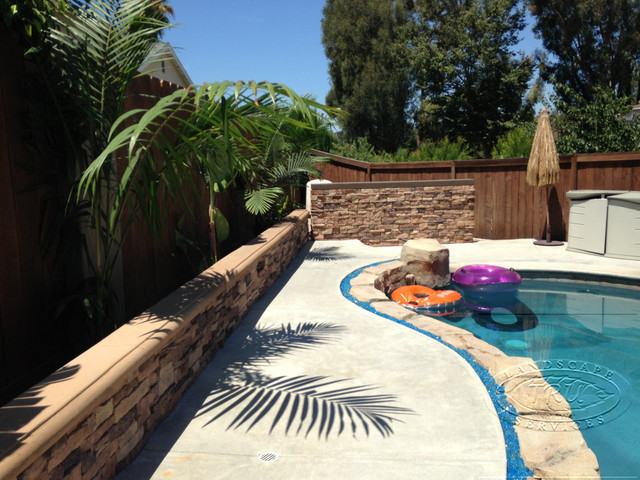 Orange County Pool deck and stacked stone walls tropical-pool