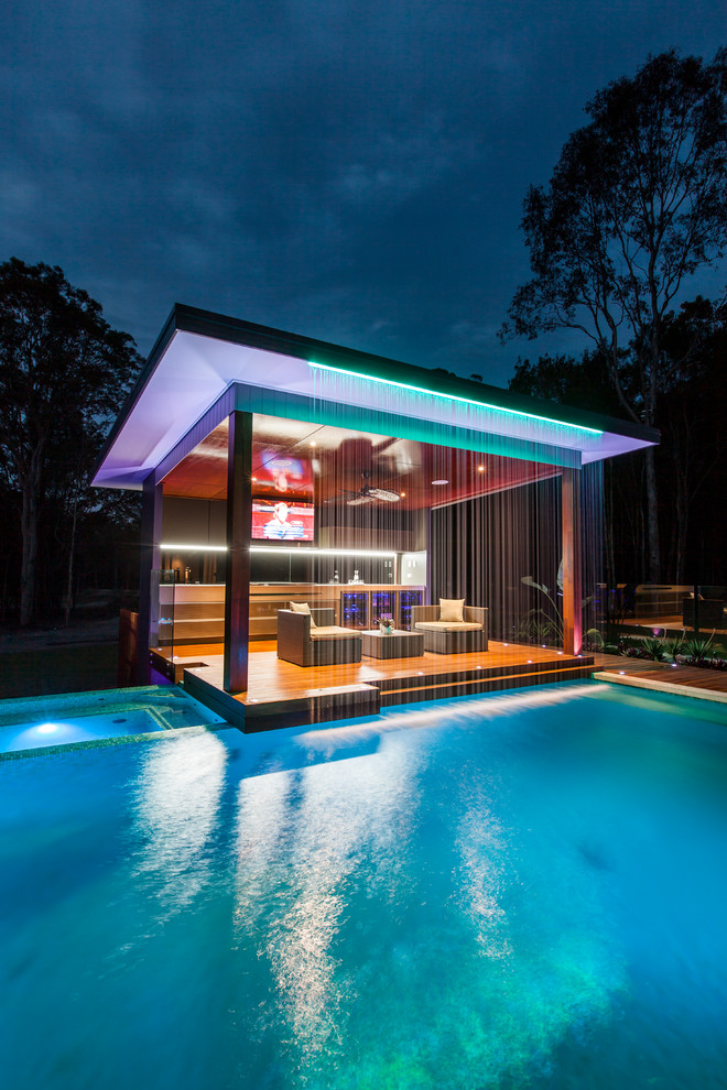 Contemporary pool in Brisbane with a pool house.