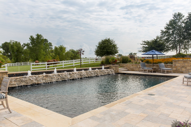 Inspiration for a large backyard rectangular natural pool fountain remodel in Kansas City