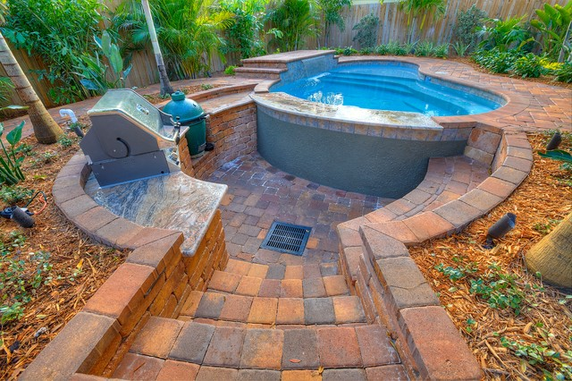 Outdoor Living with sunken kitchen Tropical Pool Tampa by