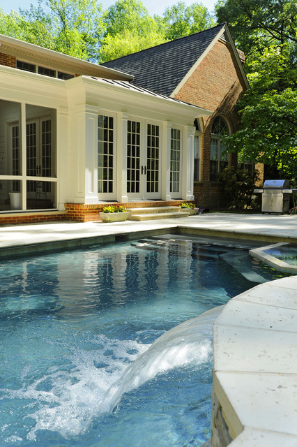 Outdoor Renovation as Part of Whole-House Remodeling Project traditional-pool