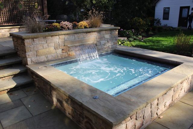 Outdoor spa traditional swimming pool hot tub for Traditional swimming pool designs