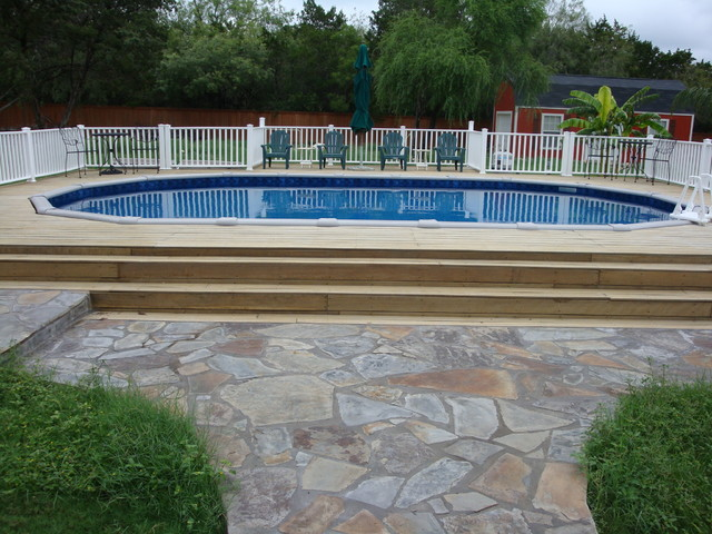 Oval above ground pool with deck traditional swimming for Above ground pool decks with hot tub