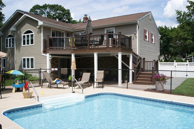 Over & Under PVC deck and Hard Scape traditional-pool