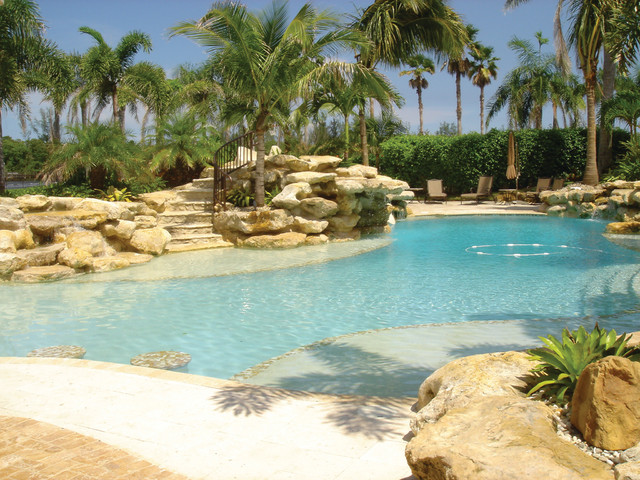 Palm beach oasis tropical pool miami by larry 39 s cap rock stone - Palm beach swimming pool ...