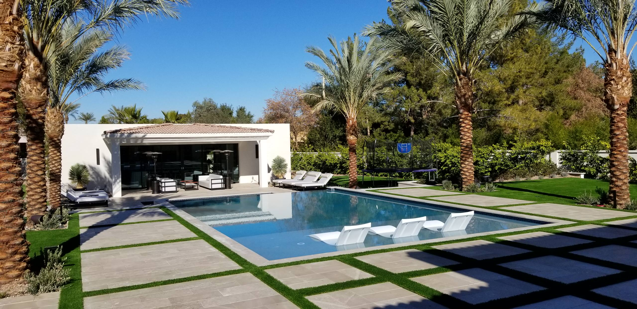 Inspiration for a large contemporary backyard stone and rectangular lap pool house remodel in Phoenix