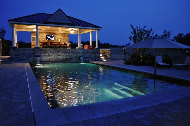 Pool house overlooking pool and patio traditional-pool