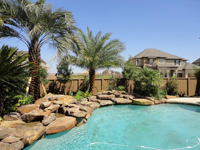 Pool Landscape - Cinco Ranch - Tropical - Pool - houston - by Bushmaster Landscape Inc