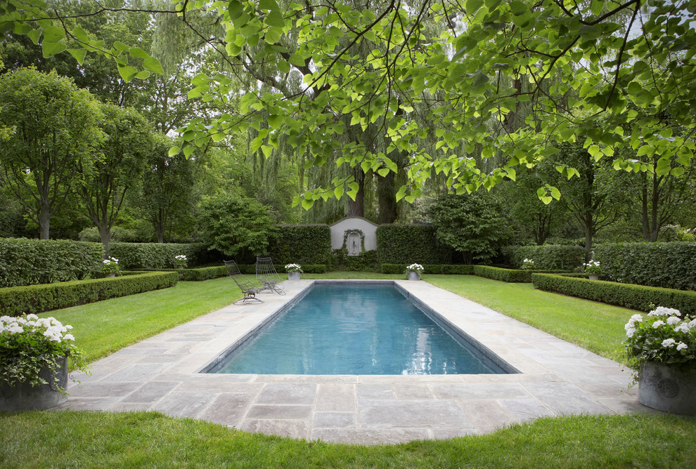Inspiration for a large timeless backyard rectangular and tile natural pool remodel in New York