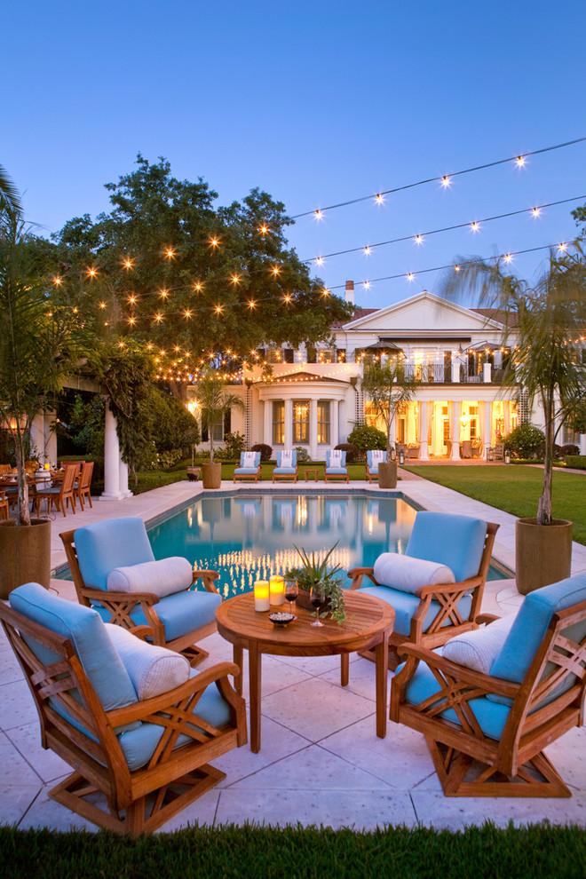 Elegant backyard rectangular and concrete paver pool photo in Orlando