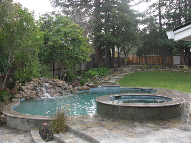 Pool spa waterfall in sloped yard mediterranean pool for Pool design for sloped yard