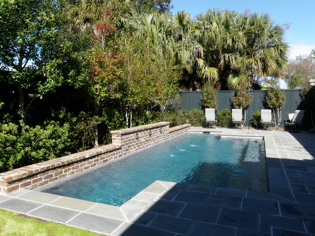 Pool waterfall and landscaping traditional pool for Pool design new orleans