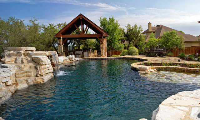 Pool Waterfall & Outdoor Kitchen traditional-pool