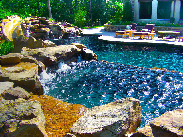 Pool with rock slide for Passarelli custom homes