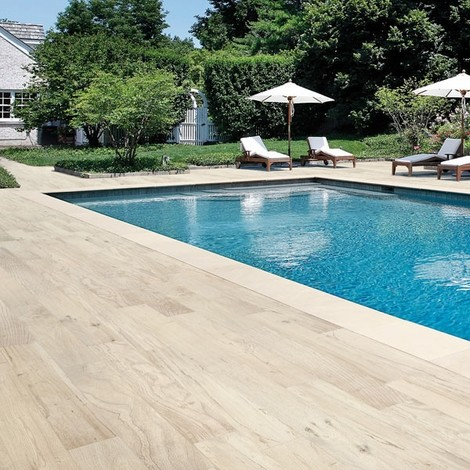 pool with wood plank tile surround traditional pool