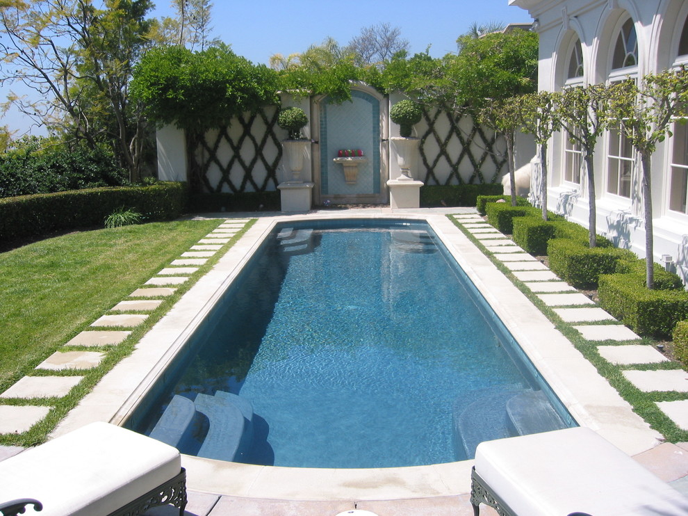 Inspiration for a large backyard rectangular pool remodel in Los Angeles