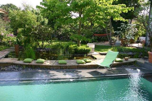 Pools mit berlauf aus naturstein mediterranean pool for Pool garden leipzig