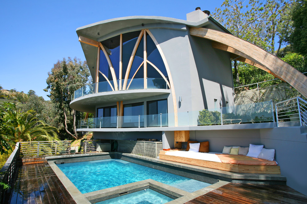 Example of an eclectic rectangular pool design in Orange County with decking