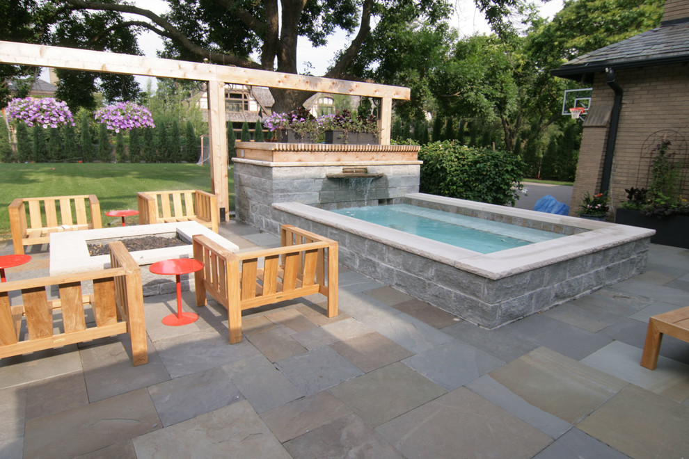 Inspiration for a small contemporary backyard stone and rectangular aboveground hot tub remodel in Minneapolis